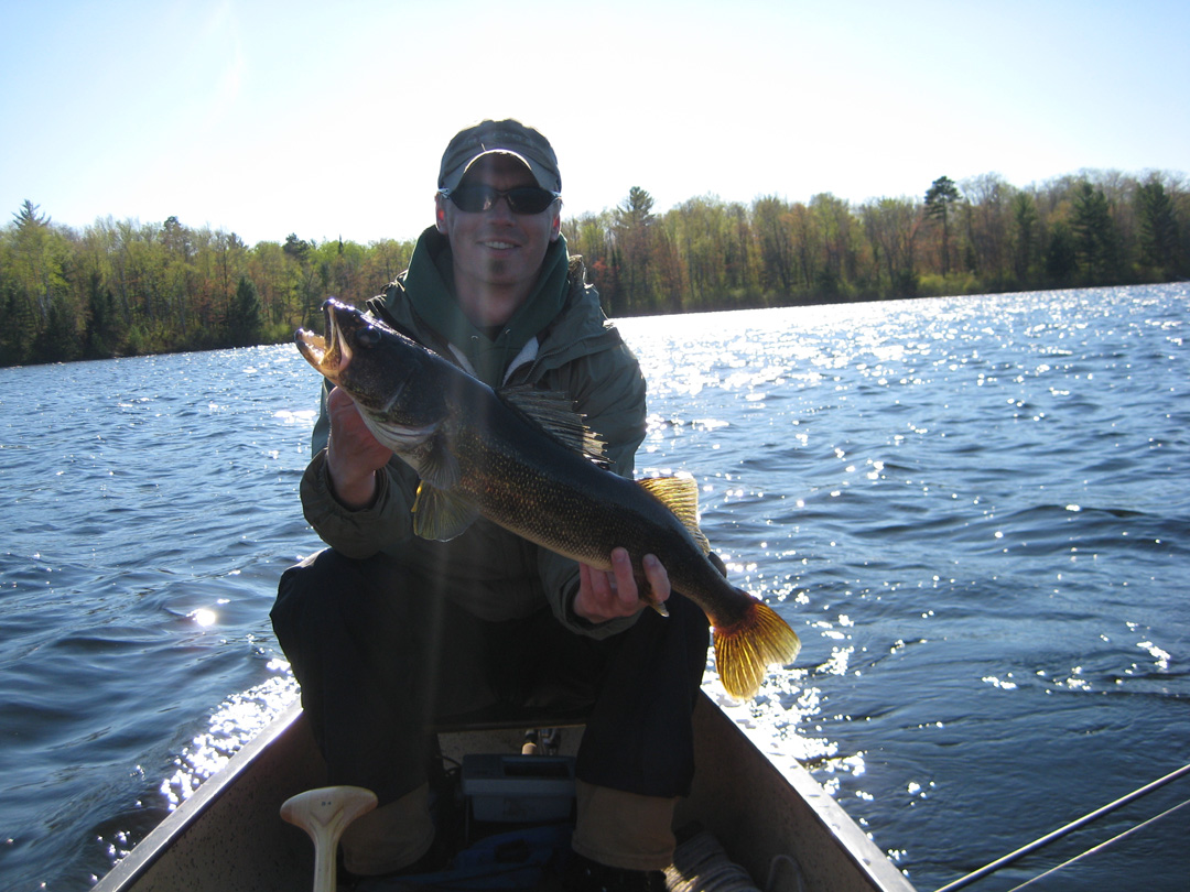 A 27 inch walleye brings a smile to Brian's face. The fish was released.