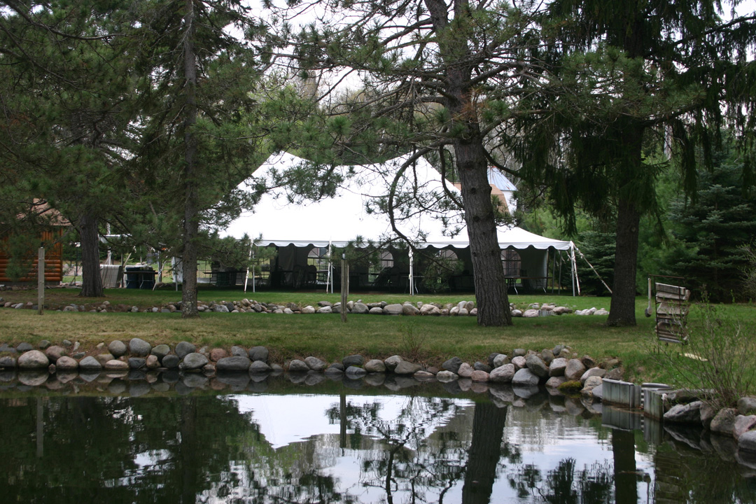The reception tent was set up right next to the barn.