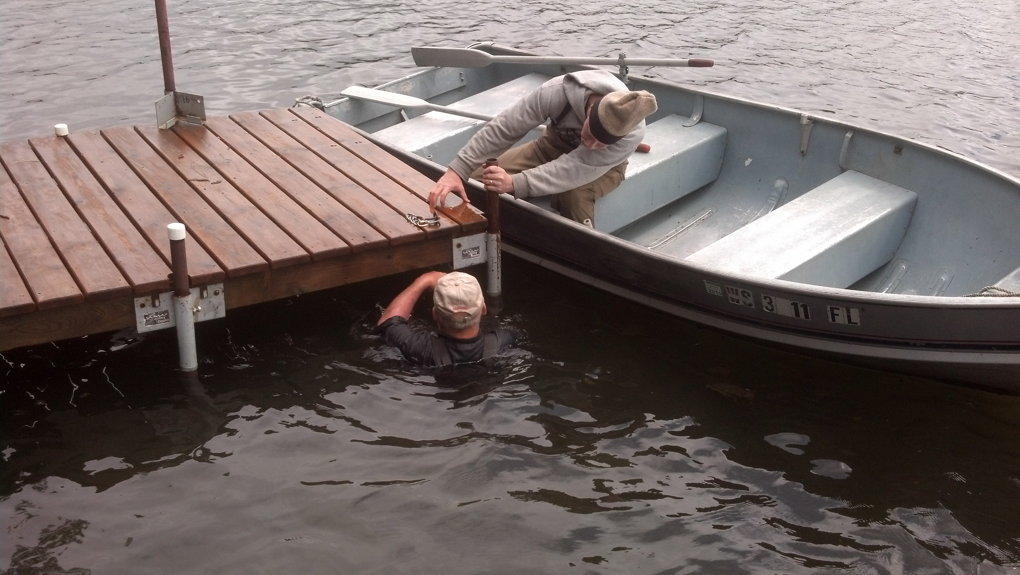 I think John A. is getting the better part of the deal. Thanks John O. for braving the cold water to help us put our docks in.