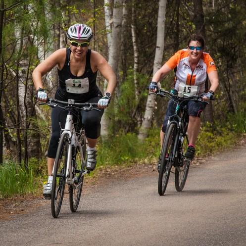 Deb and Jill riding their bikes.