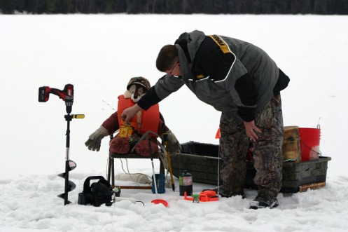 Todd making sure Charlie has all the ice fishing gear he needs to be successfull.